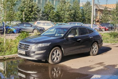 Krasnoyarsk, Russia - August 28, 2018: Honda Crosstour car is parked near new branch of social service.