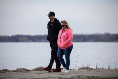 man and woman in USA, May 1, 2020, Michigan Metro Park activity during Covid 19, Corona Virus