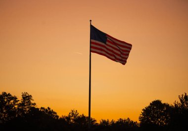 American flag stands tall in a golden sunset