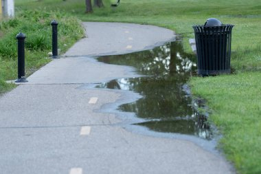 path ahead has been flooded because of heavy rains in the park