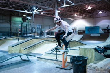 Royal Oak, Michigan, USA - 02.05.2020: bikers and skaters practice tricks at Modern Skate Park during an open skate session.