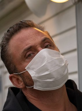 Caucasian man wearing mask during coronavirus, covid