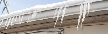 icicles are growing from the ice dams on your rooftop