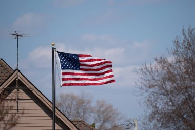 american flag on the roof of the house