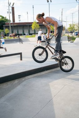 Detroit, Michigan, USA - 07.29.2020: Skaters and bikers practice tricks at an outdoor skate park during the Corona Virus in Detroit.