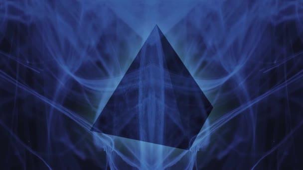 Glowing geometric pyramid. Ink in water. Blue neon
