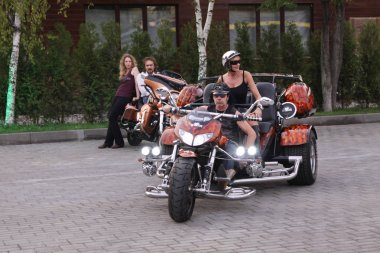 Man and a woman on a huge motorcycle at a biker Convention. Moscow. 22.07.2010