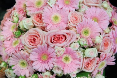 Light pink gerberas and pink roses in one big bouquet close-up