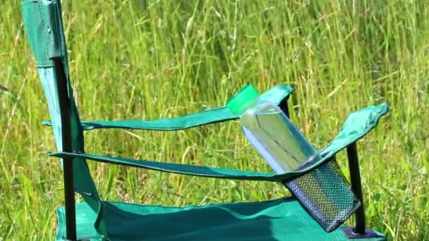 A Picnic Chair Stands On A Light Flooded Meadow. Herbs And Flowers Sway  From The Summer Wind.u2013 Stock Footage