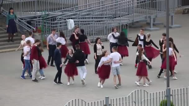 MINSK, BELARUS MAY 29, 2020 School graduates rehearsing a farewell waltz. Boys and girls perform elements of the dance.