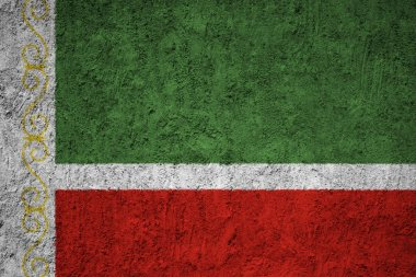 Chechen Republic Flag on the grunge concrete wall