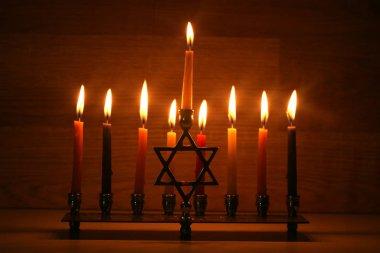 Hanukkah is a Jewish holiday. Burning Chanukah candlestick with candles. Chanukiah Menorah.