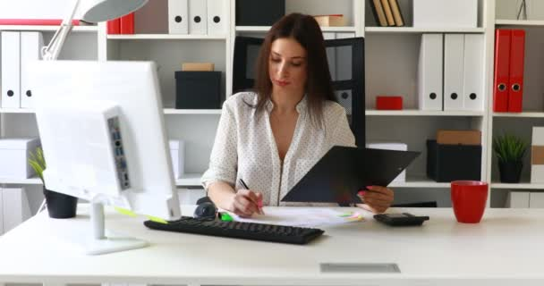 businesswoman working with documents in light office
