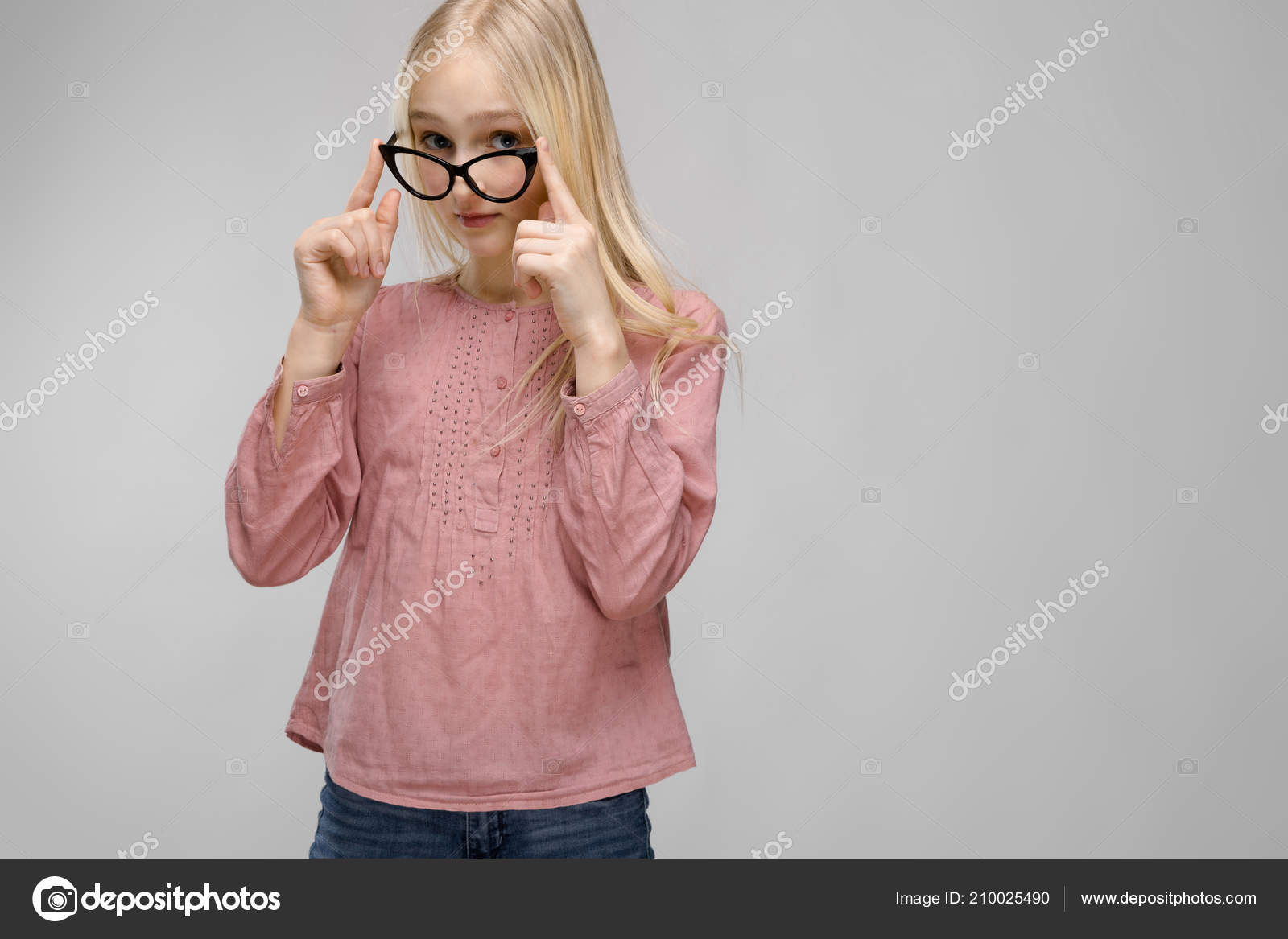 Cute blonde teen girl with glasses
