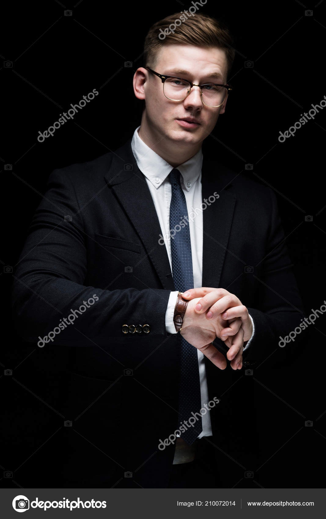 cb8b34a1d2d7 Young caucasian elegant successful smiling smart business man in black suit  and tie standing in office looking in camera — Photo by fotoevent.stock
