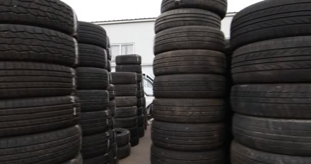 pile of used black car tires at market