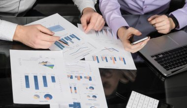 Businessmen analyzing financial data on smartphone and laptop computer.Top view.Business analysis and strategy concept. business intelligence concept, team of people working on charts and data stock vector