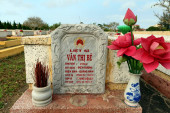 Hoi An, Vietnam, February 29, 2020: View of the commemorative monolith located in the gardens of the Martyrs Cemetery in Hoi An that pays tribute to those who died in the Quang Nam province who died in the Vietnam War 1955-1975.