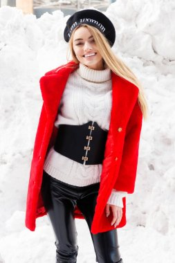 winter, fashion, people concept - fashion Portrait of a beautiful young woman walks around the city smiling red fur coat close-up snowflakes cold winter, breathe fresh air at frost winter day. sunset