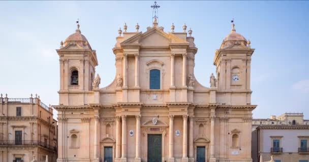Time-lapse of the unesco sicilian baroque cathedral of Noto with many tourists, Sicily, Italy