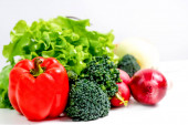 a fresh group of vegetables on white background