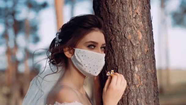 A video with a girl with a white mask decorated with shiny stones.