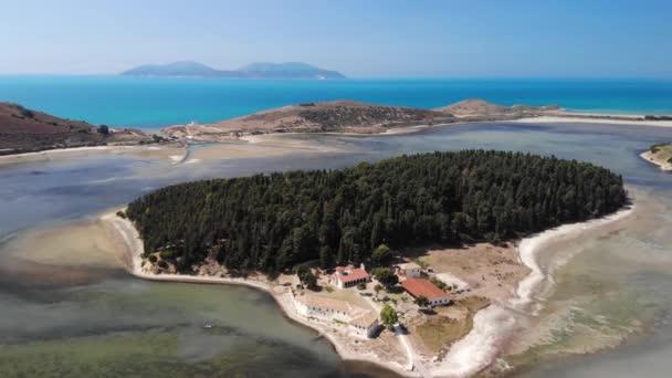 Drone aerial view on isolated Monastery of Saint Mary on Zvernec island. Narta Lagoon, Vlore, Albania