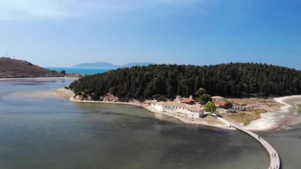 Drone aerial view on isolated Monastery of Saint Mary on Zvernec island. Narta Lagoon, Vlore, Albania