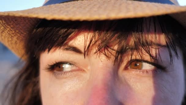 woman evaluating someone close up outdoors