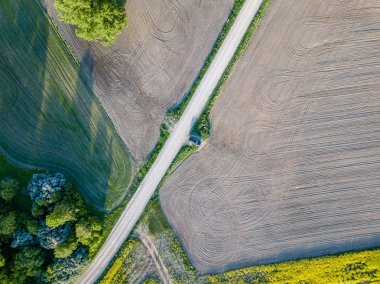 drone image. aerial view of rural area with fields and road infrastructure spring day. latvia