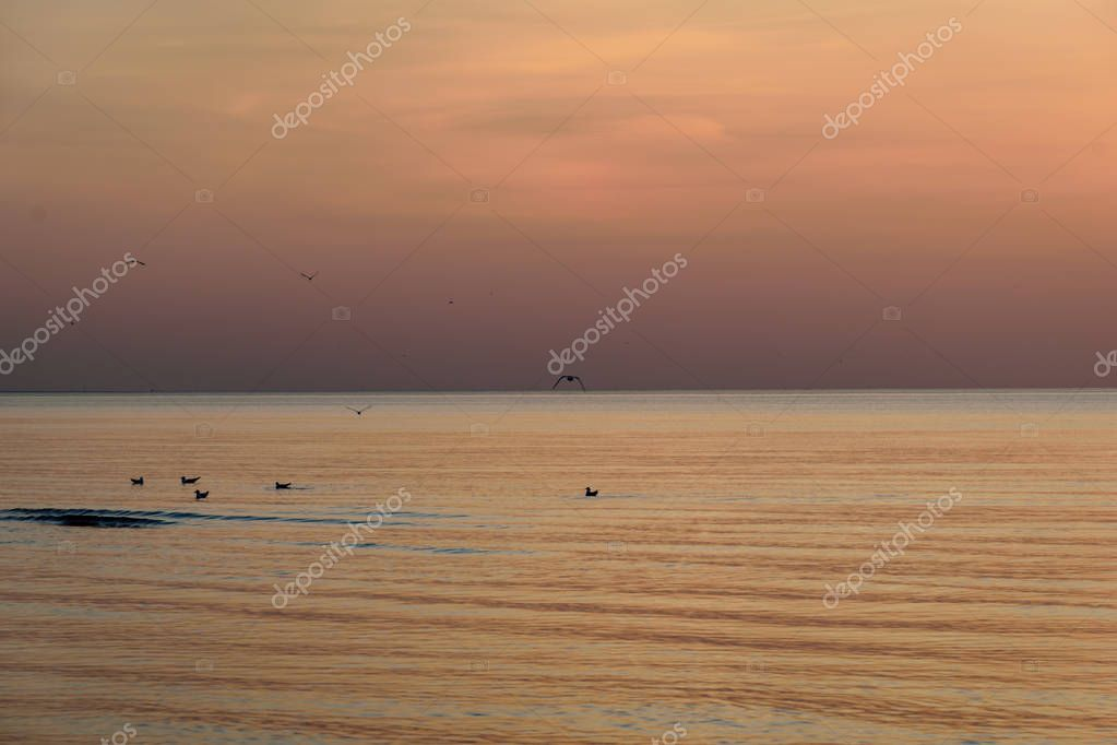Beatiful sunset in the baltic sea with dense clouds and small waves