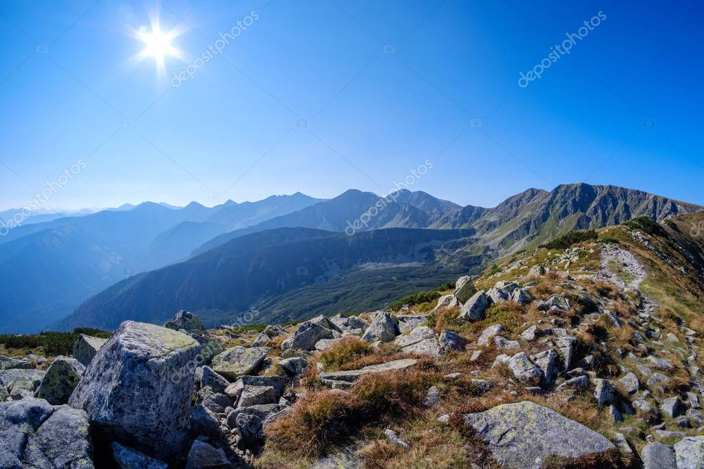 western carpathian mountain tops in  autumn mist or clouds with blue cast and multidimensional lines