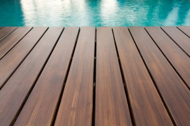 Empty Wooden Deck With Luxury Home Swimming Pool.