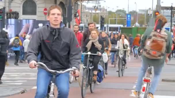 Amsterdam, Netherlands - January, 2017: people on bicycles in  Amsterdam, Netherlands