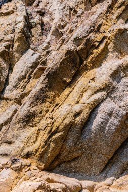 texture of the natural stone background outdoors, pattern