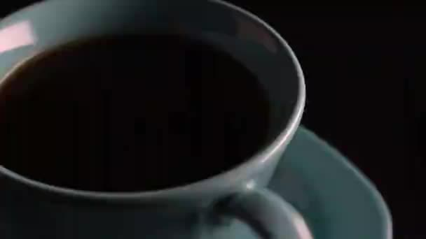 pouring fresh coffee into cup