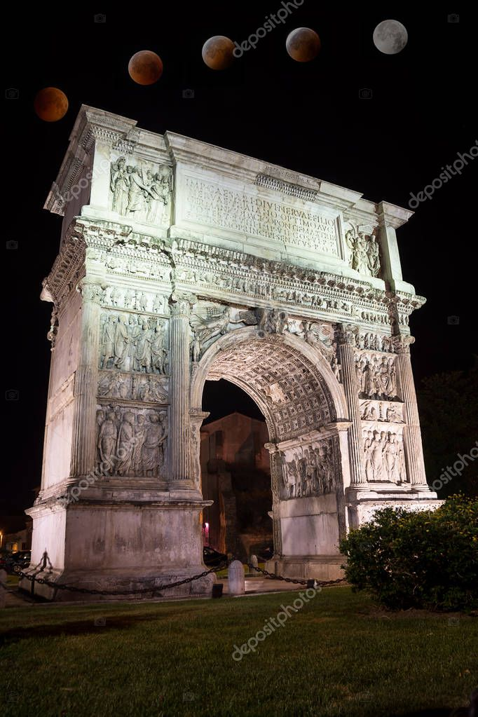 The Arch of Trajan in the night in Benevento (Italy) with total eclipse of moon