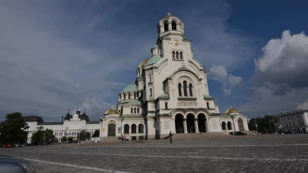 Sofia, Bulgaria - June 25, 2019: Facade of the Cathedrale Saint Alexander in Sofia and car traffic