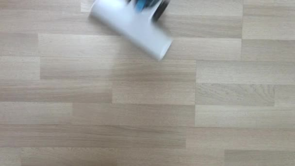 cleaning wooden floor using a vacuum cleaner