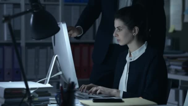 Business executives working at night
