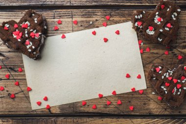 Concept Valentine's Day. Chocolate chip cookies on a wooden table. Greeting card Copy space
