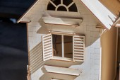 Photo Toy wooden houses with opening and closure shutters. The constructor carved from plywood for children.