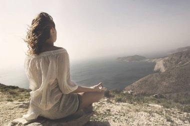 woman doing yoga exercises in front of a spectacular view