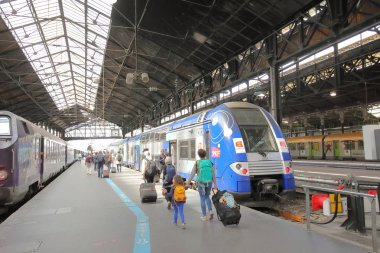 PARIS FRANCE - MAY 24, 2019: Unidentified people travel at Saint Lazare train station Paris France