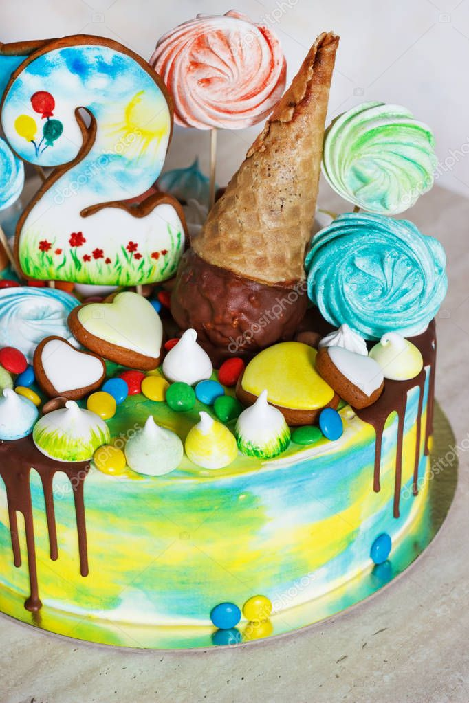 Childrens modern cake rainbow color on a white background with wood meringue