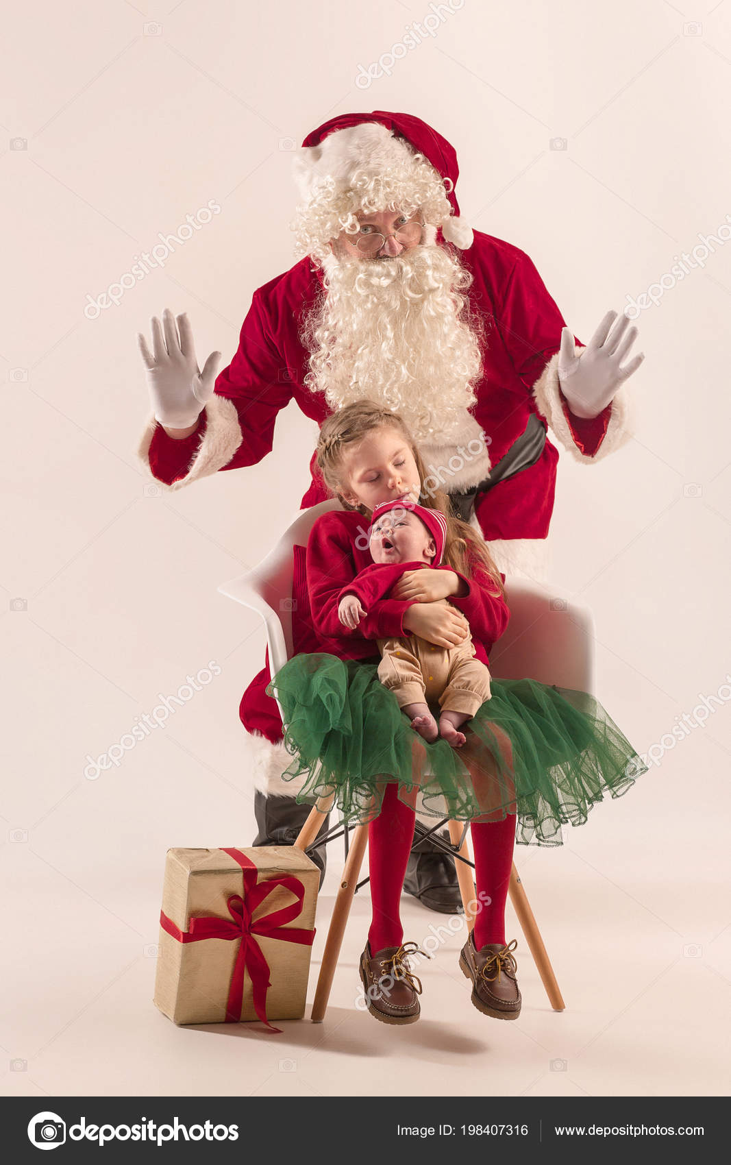 e4addf824a8f0 Christmas portrait of cute little newborn baby girl, pretty teen sister,  dressed in christmas clothes and man wearing santa costume and hat, studio  shot, ...