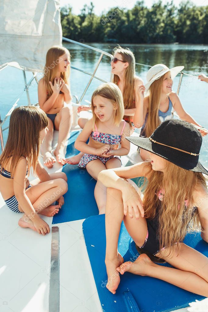 The children on board of sea yacht