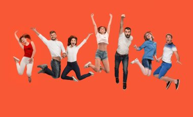 Freedom in moving. Mid-air shot of pretty happy young man and women jumping and gesturing against studio background. Runnin girl in motion or movement. Human emotions and facial expressions concept stock vector