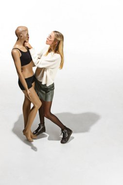 Fashion woman body. The woman hugging mannequin, perfect woman dream concept
