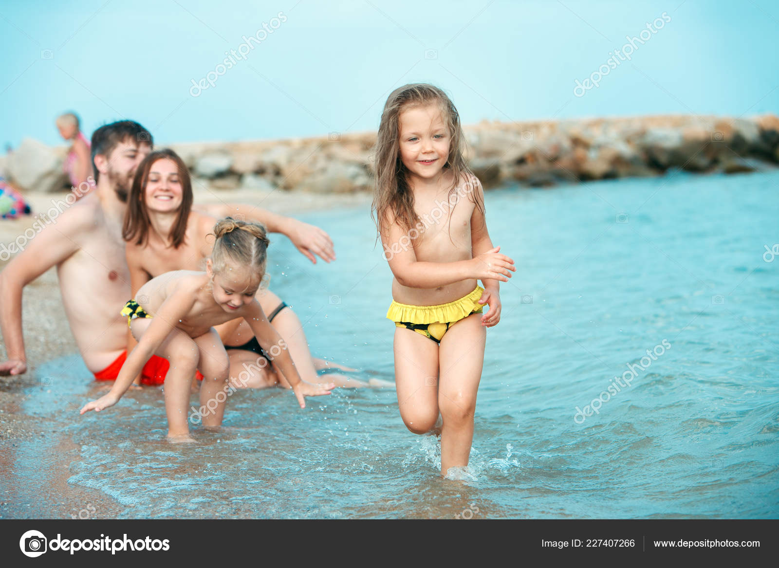 https://st4.depositphotos.com/3917667/22740/i/1600/depositphotos_227407266-stock-photo-happy-family-enjoying-walk-on.jpg